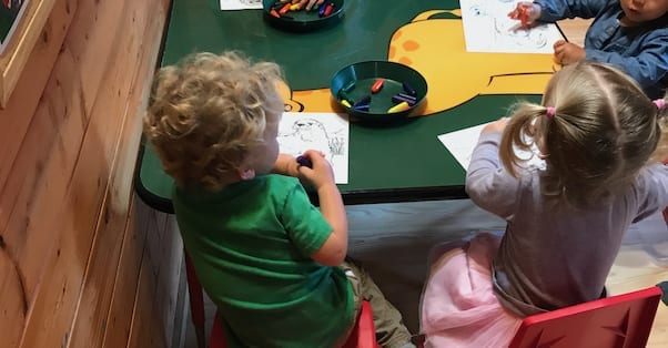one year olds sitting at table