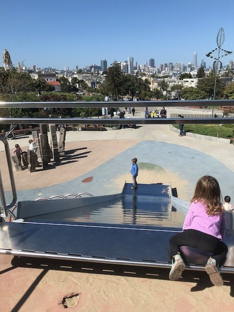View of San Francisco City Skyline from the top of the slide at Helen Diller Playground