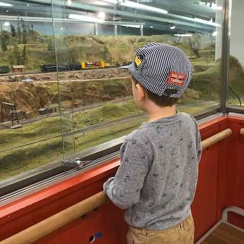 Boy watching model train at the randall museum in san francsico