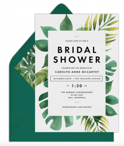 Tropical Bridal Shower invitation with green palm leaves printed on it
