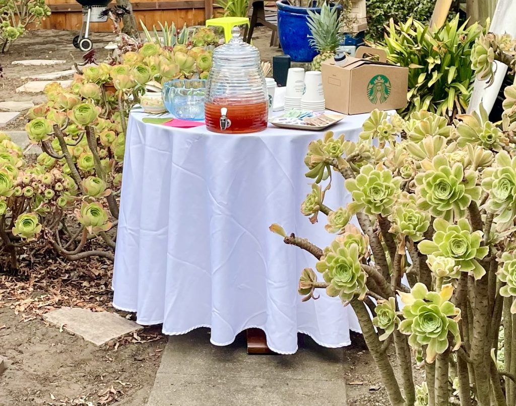 drink station with white tablecloth and iced tea dispenser