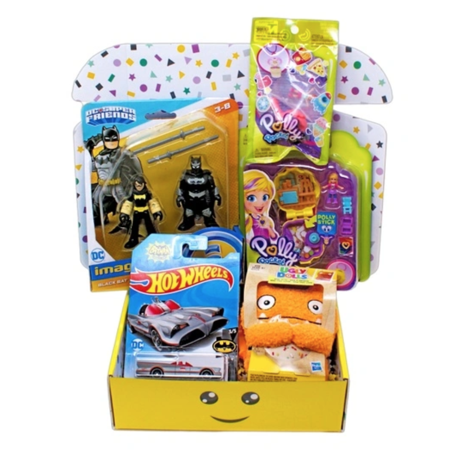 Box with Batman toy, Polly Pocket Toy, a Hot wheels car and other toys. Subscription box from Toy Box Monthly
