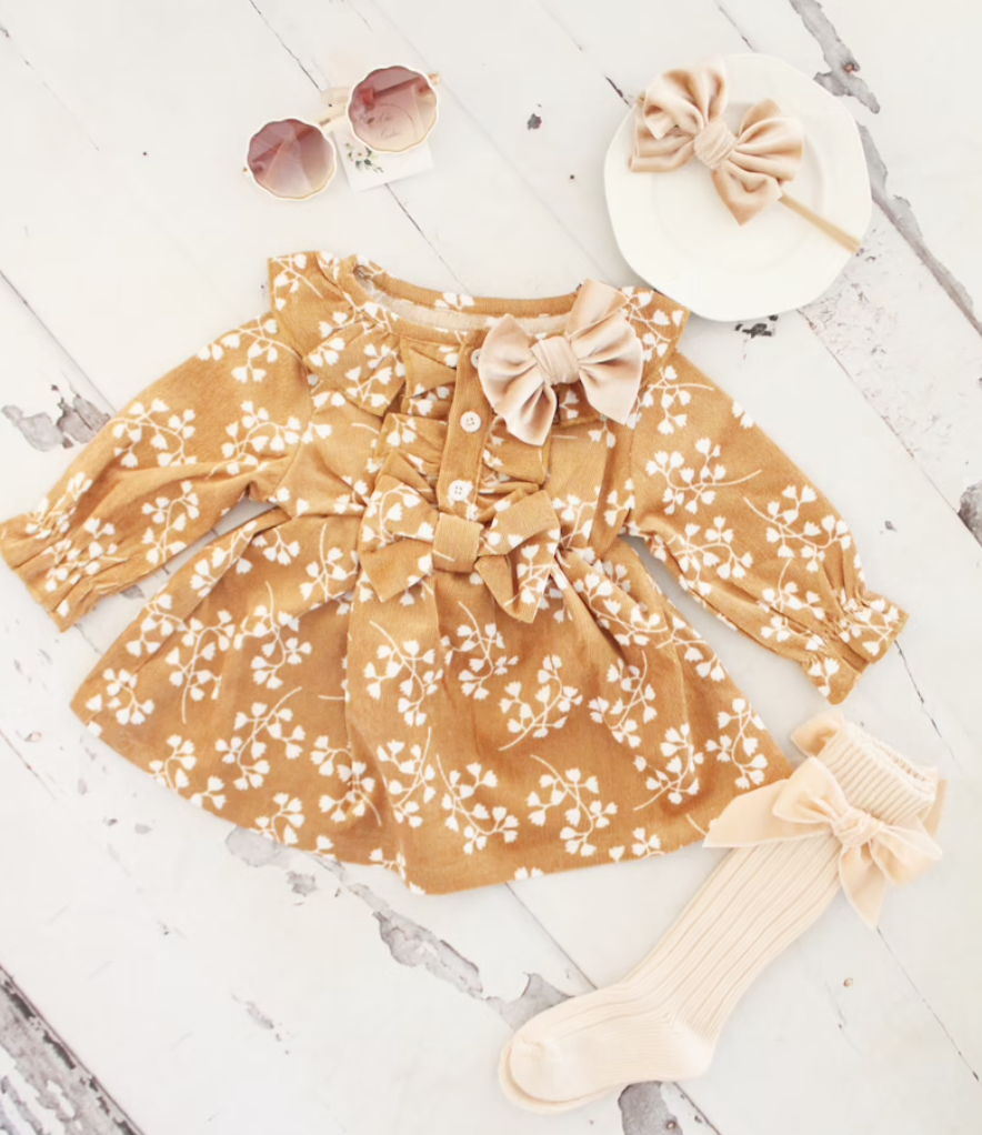 Fall dress for baby tan with a bow on the collar